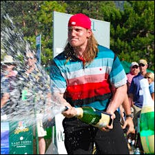 Photograph of A.J. Hawk with magnum of Korbel.
