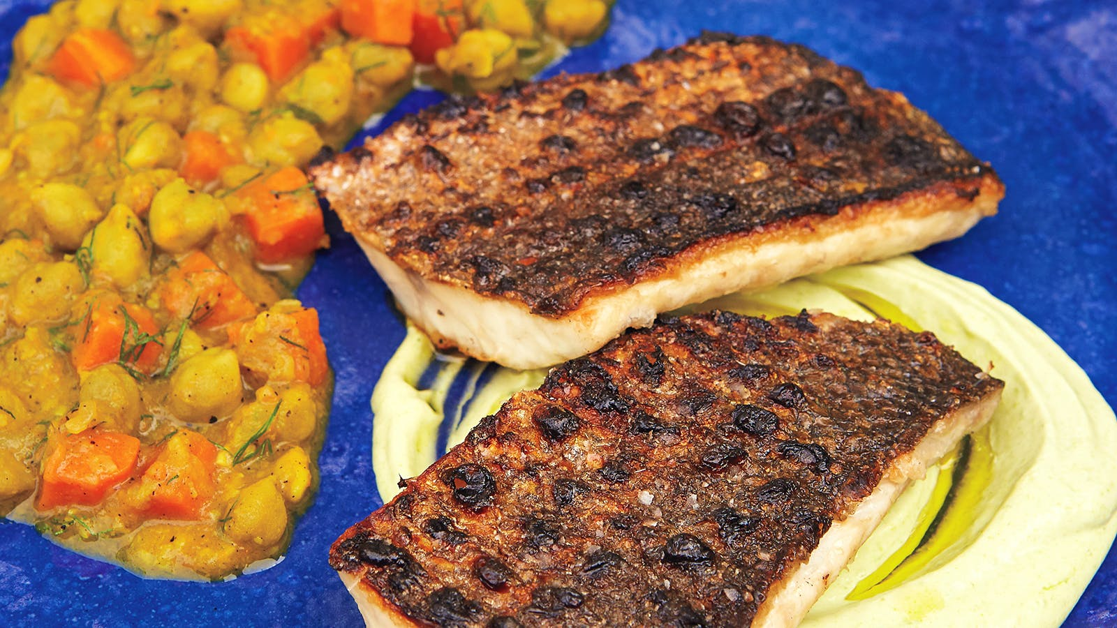 A place of two grilled branzino fillets with chickpea stew