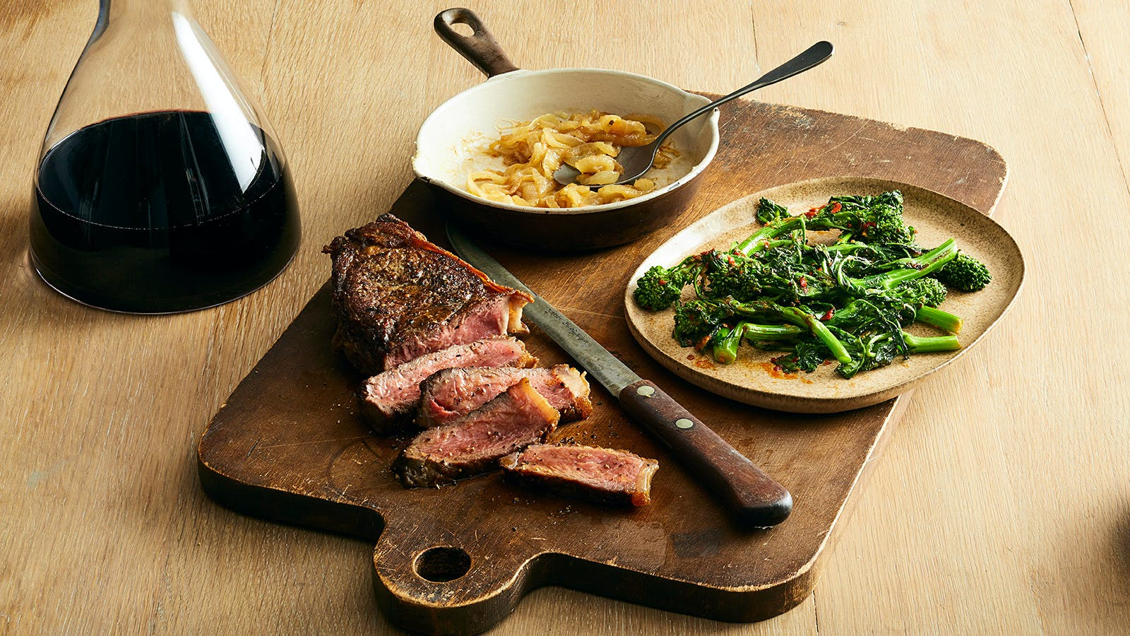 New York Strip Steak with Buttered Onions & Chile Skillet Broccoli Rabe