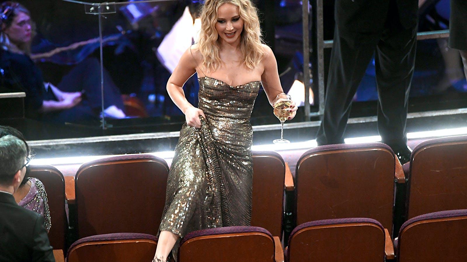 Jennifer Lawrence Juggles Wine, Wolfgang Puck('s Photog) Fights Crime at Oscars