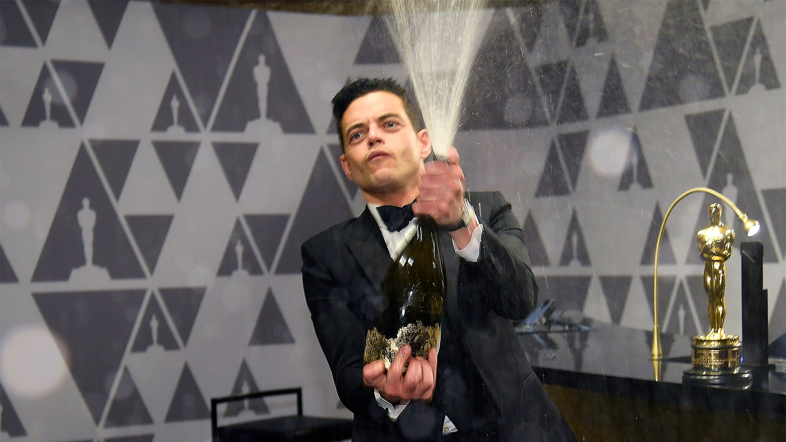 Oscars Wine Time! Rami Malek Sprays Champagne; Francis Ford Coppola, Wolfgang Puck Dish on Their Pours and Snacks