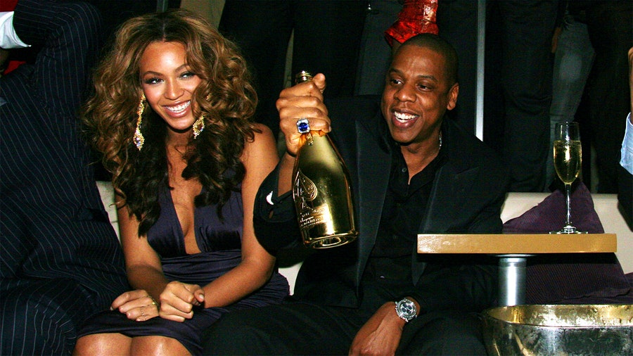 Beyoncé and Jay-Z with a bottle of Champagne