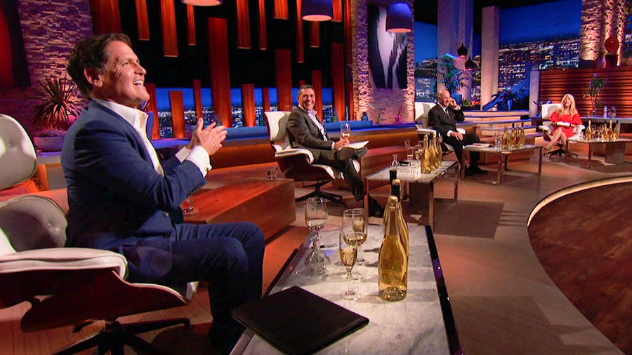 Shark Tank star Mark Cuban samples Bee d'Vine honey wine.