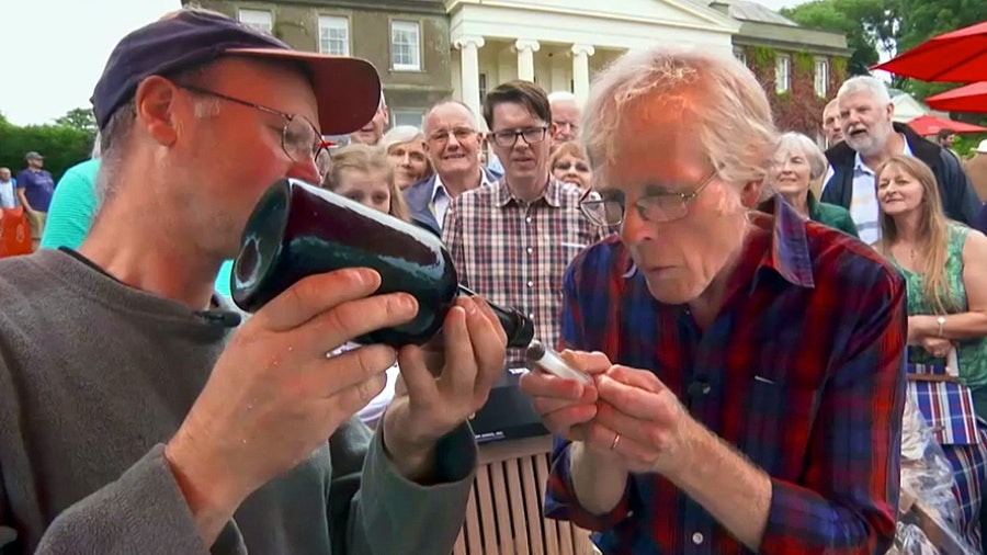 <em>Antiques Roadshow</em>'s Andy McConnell extracts a sample from a very old wine bottle …