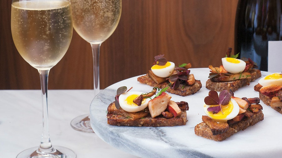 The earthy flavors in a canapé of rye toast topped with crispy mushrooms and a quail egg pair well with a creamy, Pinot Noir–driven Champagne.