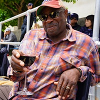 Dusty Baker takes in a college game with a glass of his own wine.Dusty Baker's Homage to Hank Aaron