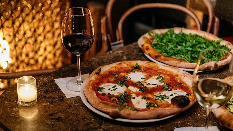 Restaurants like New York's La Lanterna di Vittorio know that wine and pizza make a great match.
