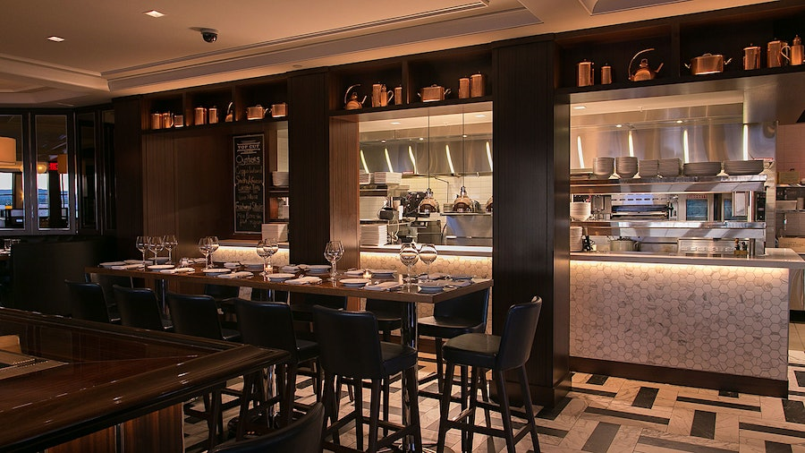 Guests of Top Cut Steak House can enjoy views of the open kitchen, as well as a Cabernet Sauvignon–focused wine list.