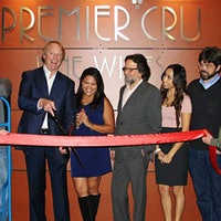 John Fox, in 2011, cuts the ribbon on now-bankrupt Premier Cru's new location.Wine Ponzi Schemer John Fox Released Early from Prison