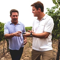 Passing Time's Dan Marino and Damon Huard work on their handoff technique.Wine, Spirits and Restaurant Industries Step Up for Autism, Black History Month and More