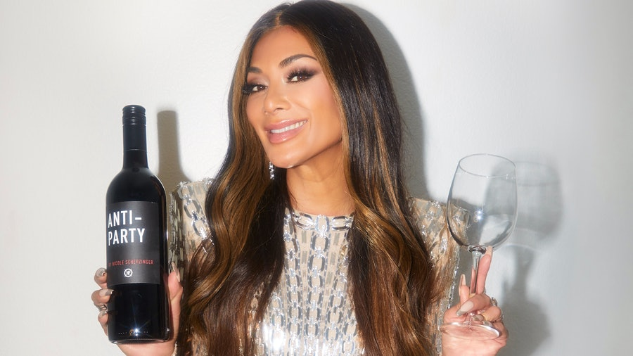 Party for one: Nicole Scherzinger enjoys a bottle of Anti-Party wine.