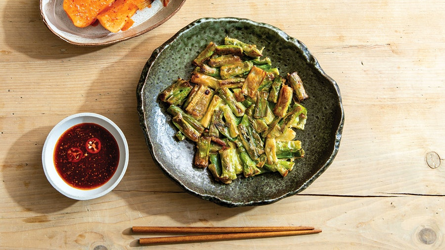 Chef Hooni Kim's version of scallion pancakes have just enough batter to hold them together, keeping the focus on the springtime veg.