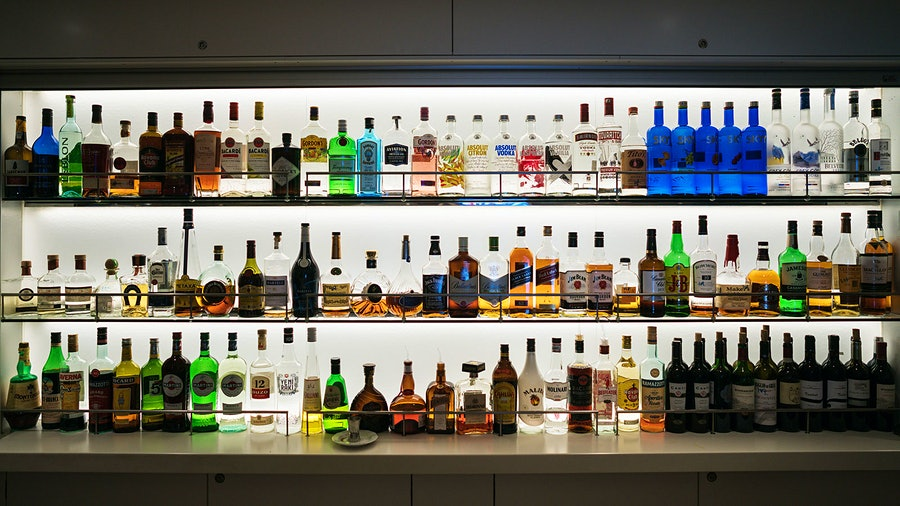 A bar with bottles of whisky, vodka and other spirits