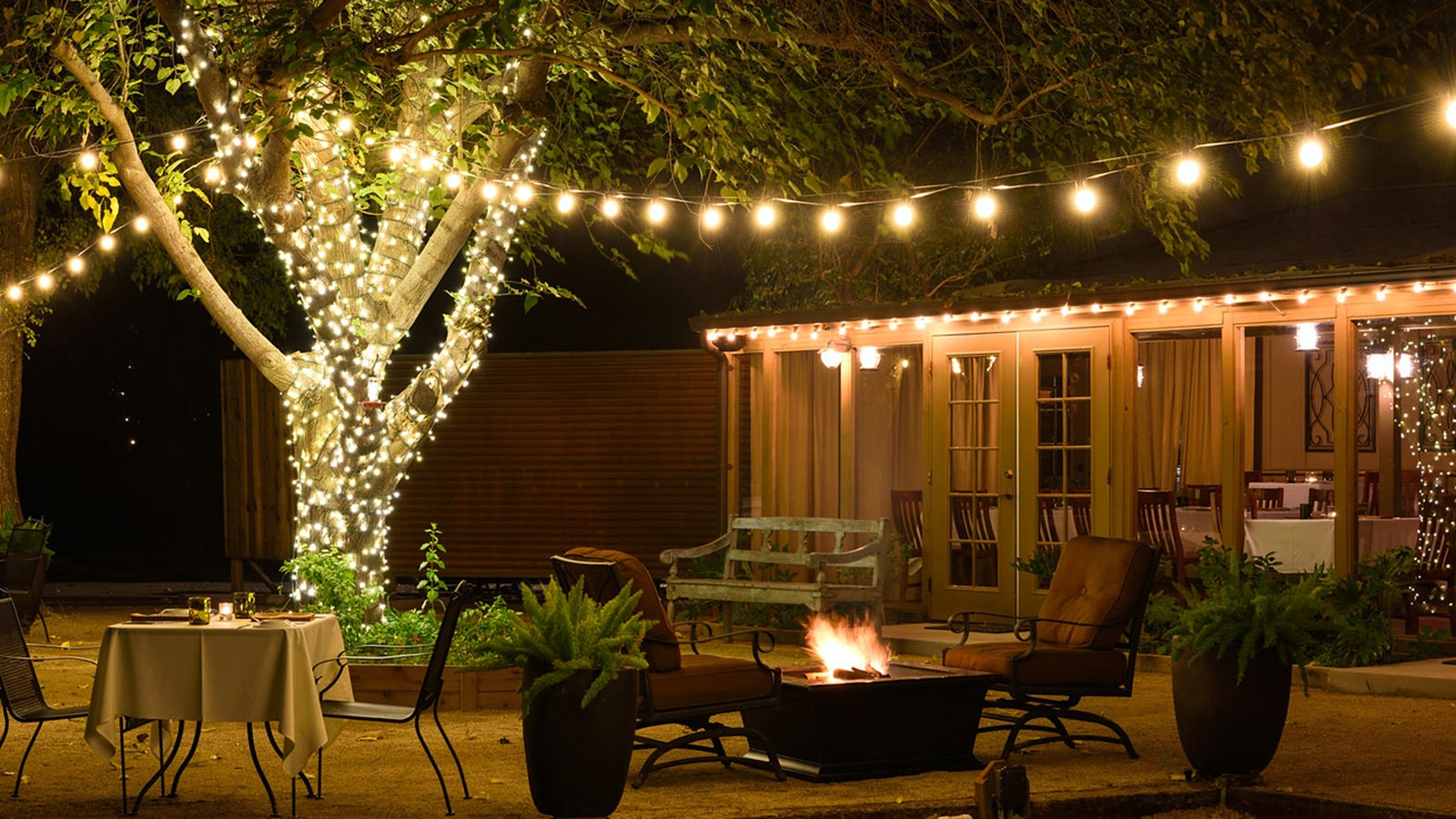 Nighttime shot of the outdoor dining area at Quiessence at the Farm