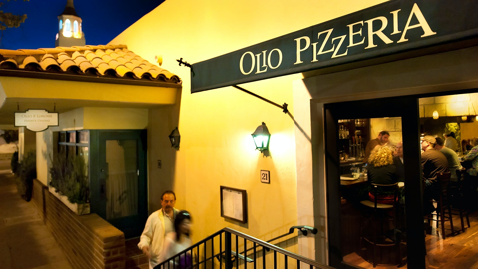 The entryway and sign of Olio Pizzeria