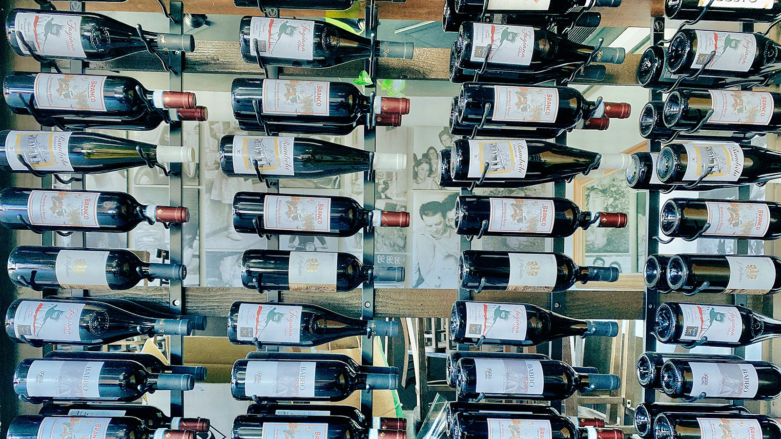 A wall of wines at Osteria Mamma