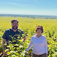 Evenstad Estates' winemaking and viticulture vice president Michael Fay, left, owner and founder Grace Evenstad and CEO/President Ryan Harris stand in Burgundy's Clos de Vougeot vineyard.Oregon's Evenstad Estates Buys Burgundy Domaine and Vineyards