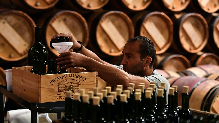 A cellar worker readies barrel samples at Château Margaux. The First Growth released its 2020 futures on June 22.