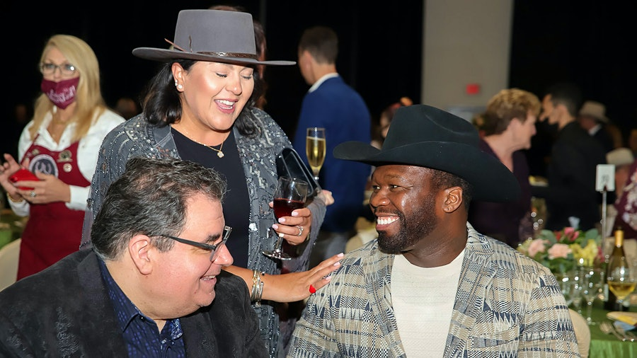 50 Cent, aka Curtis Jackson, was the guest of honor at the Houston Livestock Show and Rodeo's charity wine auction, where his Champagne drew feverish bidding.