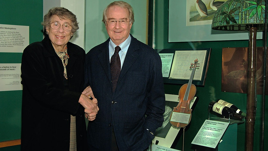 Barbara and Warren Winiarski stand next to their 1973 Napa Cabernet at the Smithsonian's National Museum of American History.
