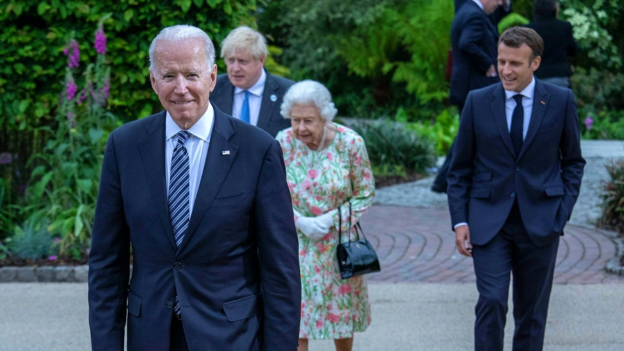 From left: U.S. President Joseph Biden attends the G7 Summit with Britain's Prime Minister Boris Johnson, Queen Elizabeth II and France's President Emmanuel Macron.