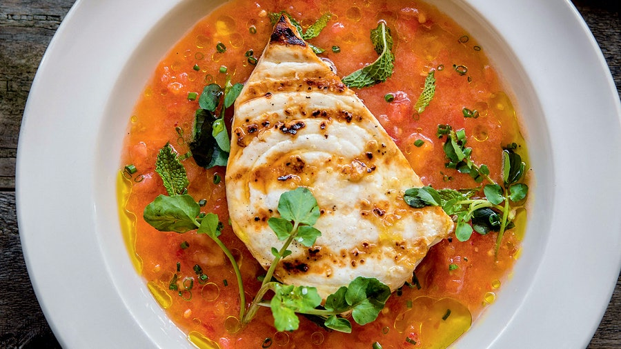 For this summertime recipe, quality ingredient–focused chef Jonathan Waxman highlights swordfish, which is considered among the most sustainable seafood. Shown here is a riff on the adaptable tomato-cucumber condiment that's served alongside.