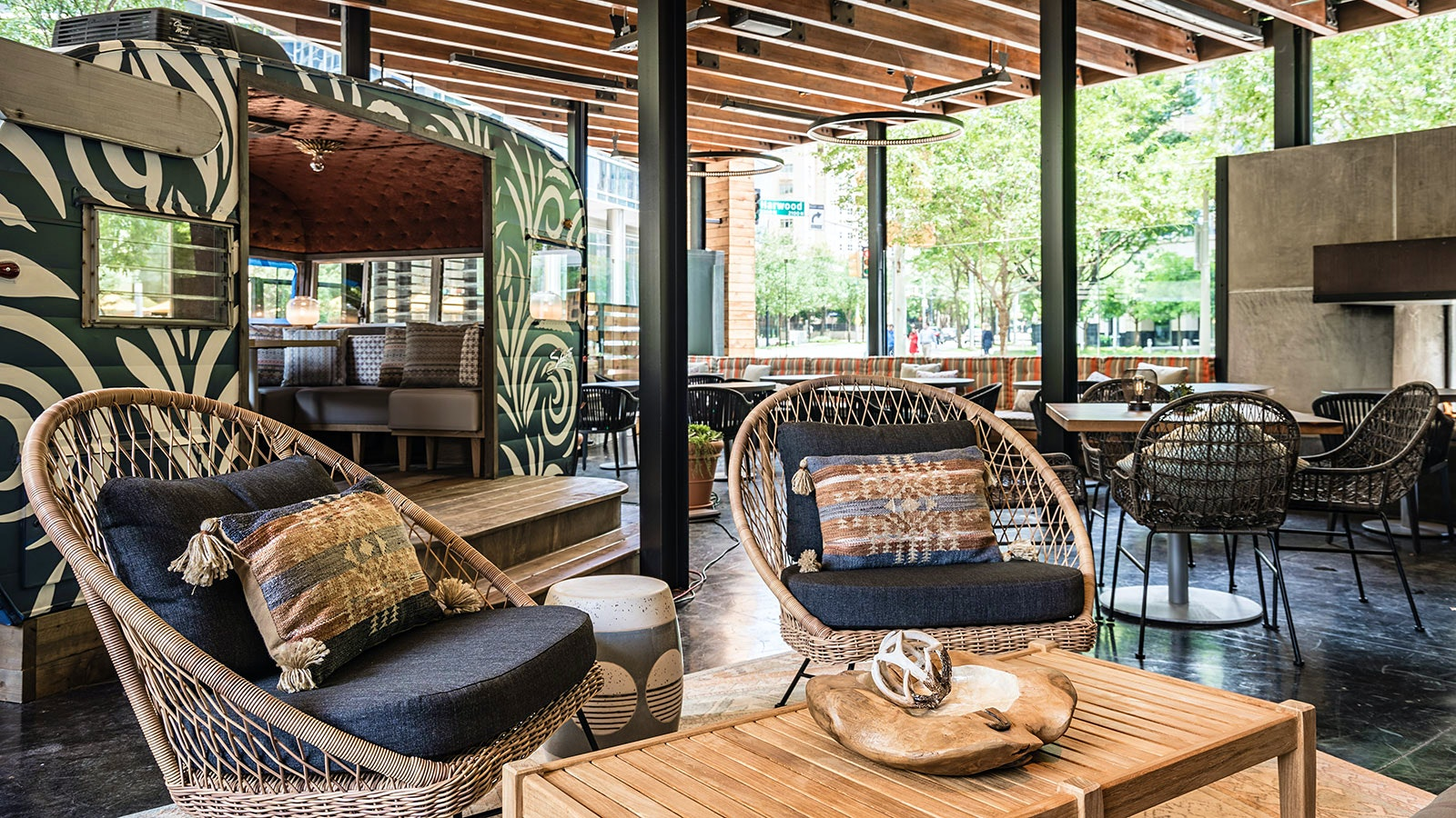 Outdoor patio area with a retractable roof at Haywire in Dallas
