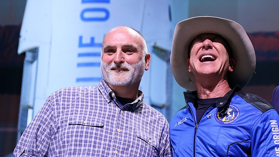 After safely landing in Texas in his Blue Origin spacecraft, Jeff Bezos, right, announced a $100 million award to José Andrés to help his humanitarian efforts.