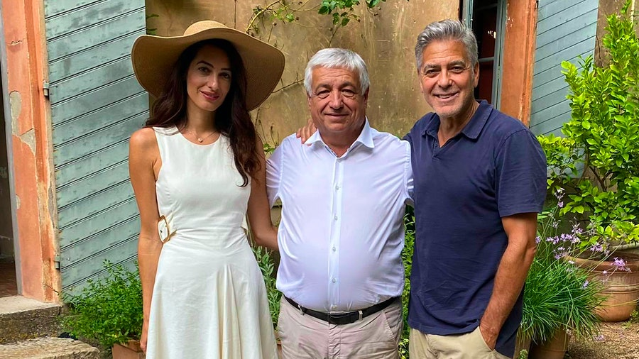Amal and George Clooney with Brignoles Mayor Didier Brémond (center) at the couples' new wine estate in Provence, France