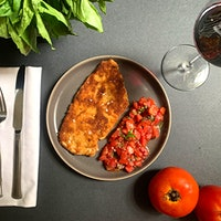 Like tomato bruschetta? Then you'll love this simple chicken recipe for savoring the last few moments of summer.Crispy Chicken with Tomato Topping and Lambrusco