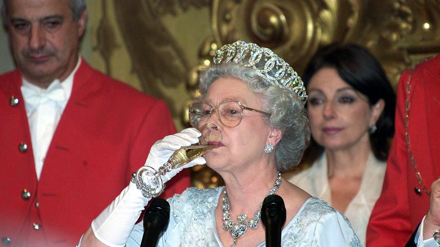 Queen Elizabeth II of the United Kingdom sipping a glass of sparkling wine