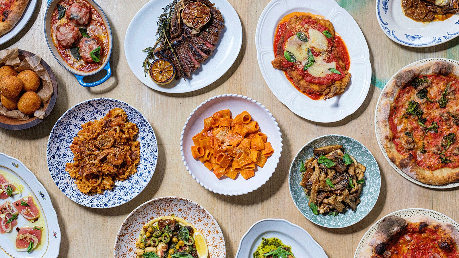 An overhead view of a spread of dishes at Alla Vita