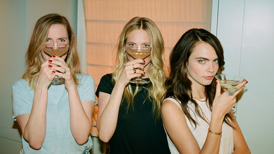 From left: Chloe, Poppy and Cara Delevingne celebrate their sisterly bond with Della Vite Prosecco.