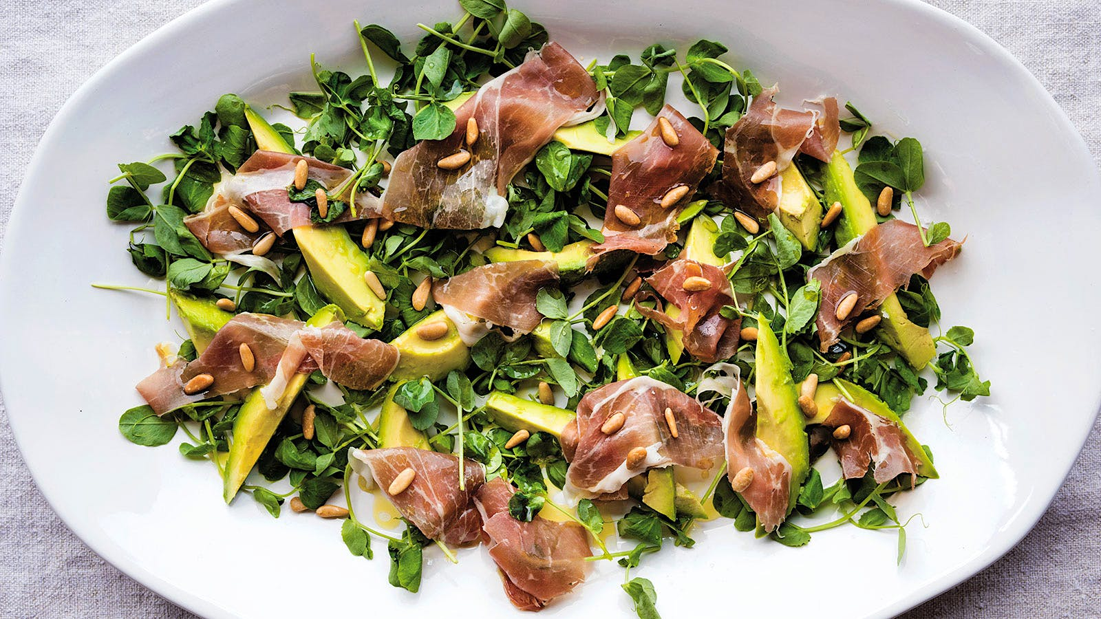 Pinkerton Avocadoswith Pea Shoots, Toasted Pine Nuts and Prosciutto