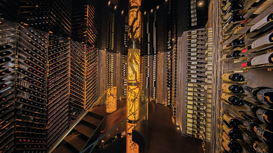 Artist and cellar designer Robert Cameron created a 14-foot-tall sculpture filled with different decades of Sauternes as the centerpiece of a client's home cellar in Toronto.