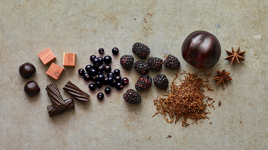 Ginger, a plum, blackberries and other objects representing the flavors of Cabernet Sauvignon