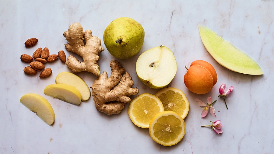 Pear slices, melon, ginger, lemon and other items representing the flavors and aromas of Pinot Gris